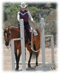 Melissa doing a trail course with her horse Lacey